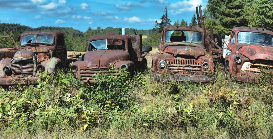 Four rusty trucks heal crop Topaz dark 1680.jpg